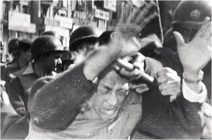 large-Habib Jalib being beaten up at a WAF protest during the Zia regime