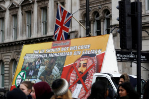 Demonstrators drive a van with a large protest poster on it during a protest against the visit by Saudi Arabia's Crown Prince Mohammad bin Salman in central London