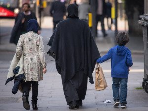 A general view of two Muslim women and a child in London.