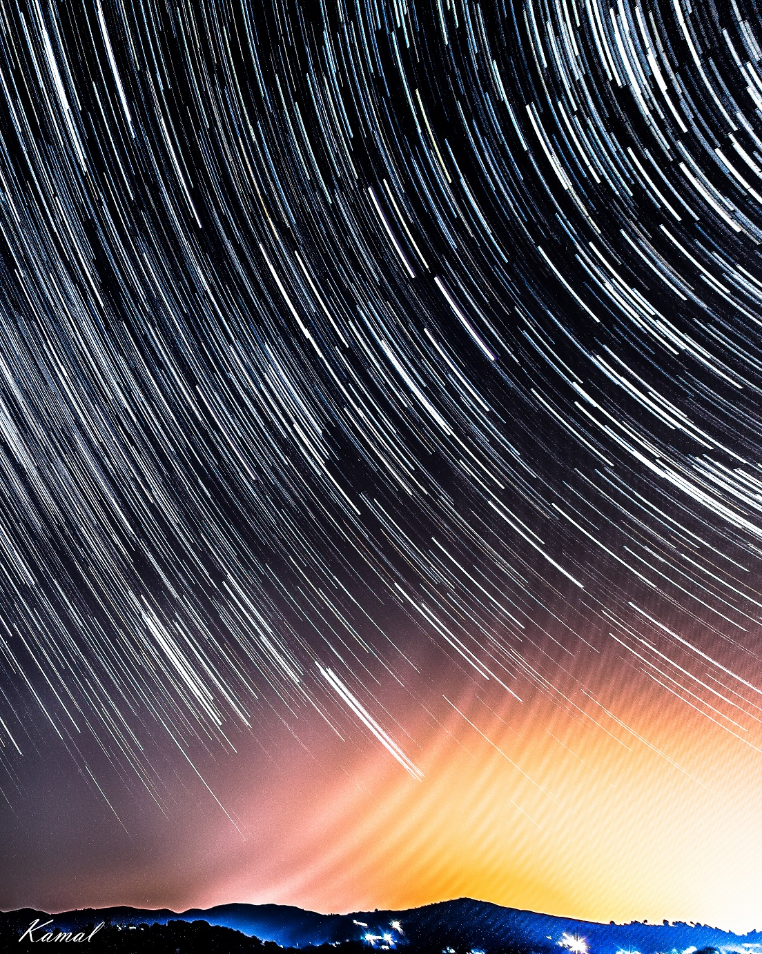 Photo by Ahmed Kamal showing star trails