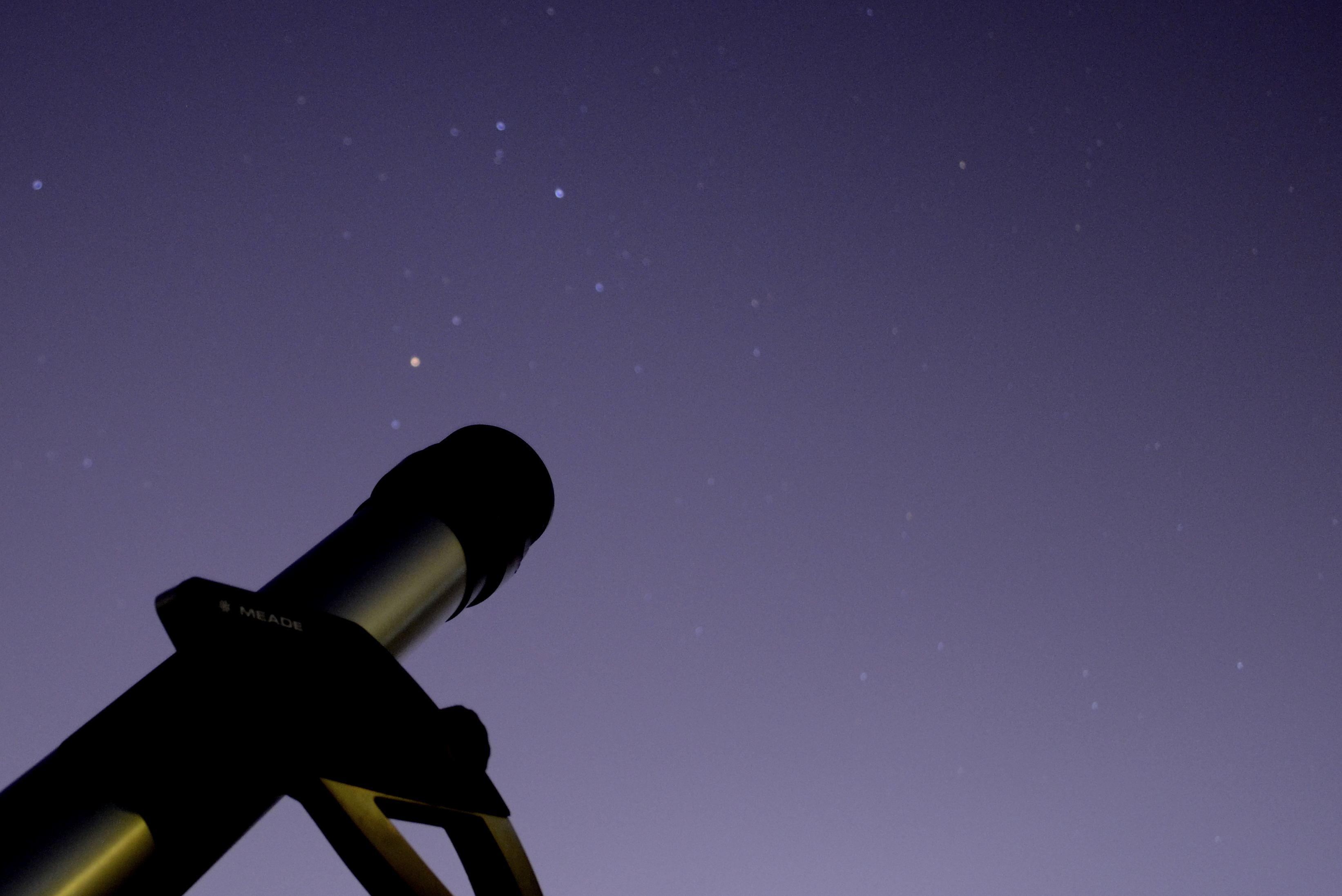 Photo by Author showing a small telescope with the backdrop of stars of the Scorpio constellation taken from Lahore
